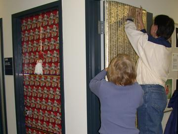 Staff in the '90s start decorating office doors to raise funds to support a family in need within the nursing community.